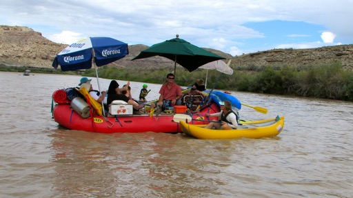 Potts raft with Suzi on kayak
